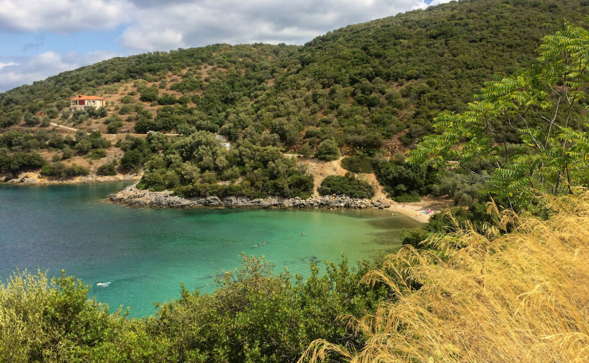 Behind us were rocks, bushes and an abandoned tiny beach house...spreading before us was the grand blue sea and golden sand...Pelion Decameron